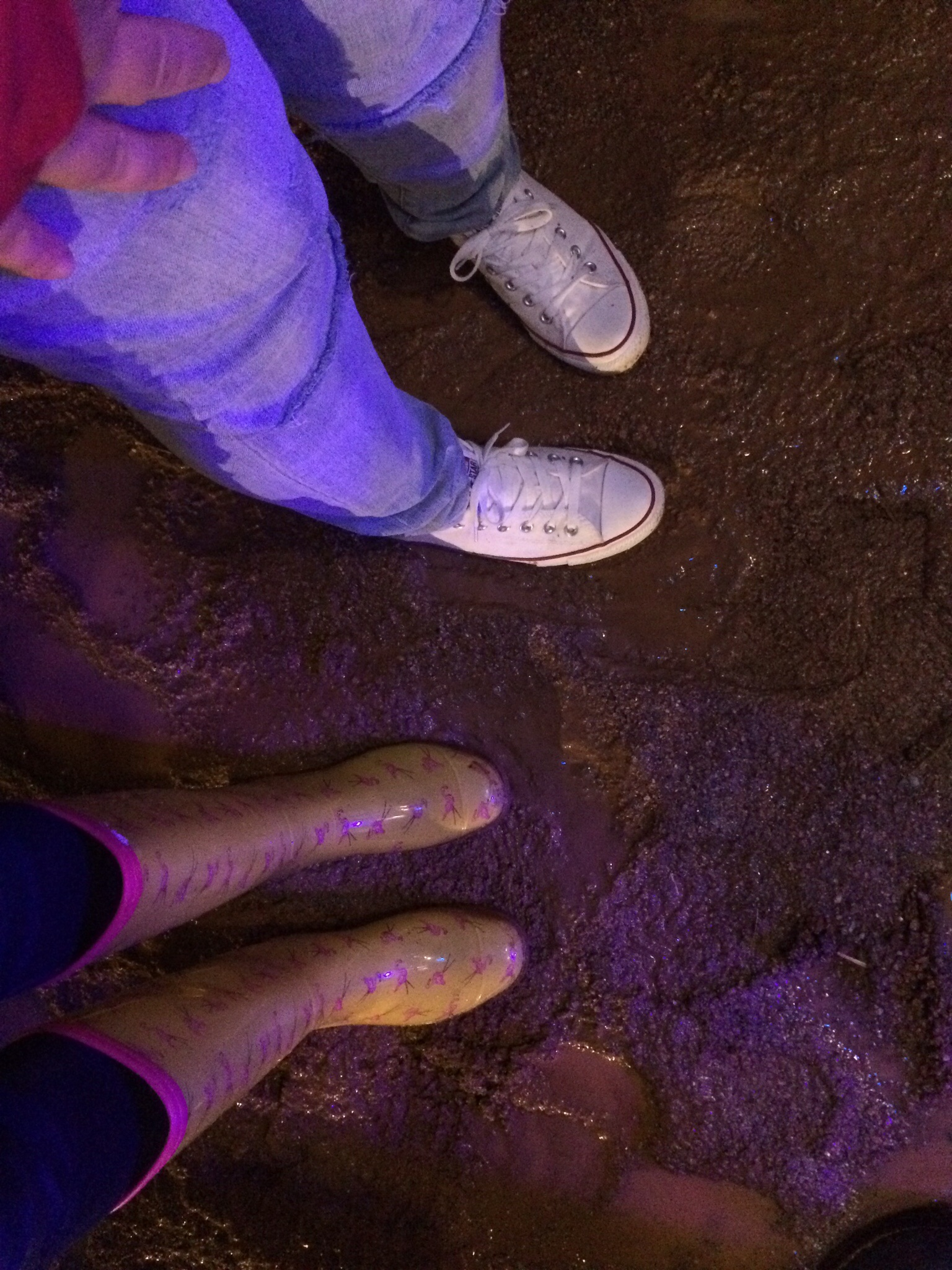 The mud we were standing in--at least I'm in rain boots!